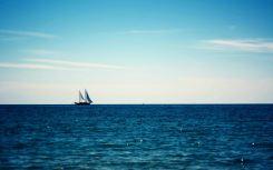 Sailing-Ship-on-Horizon-Wallpaper
