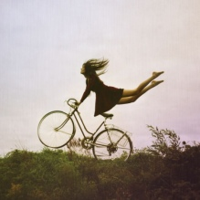 extreme-bicycle-woman-flying-hands-dress