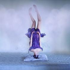 Heaven-head-stand-purple-clouds
