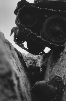 war-tank-tracks-over-head-trench-black-white