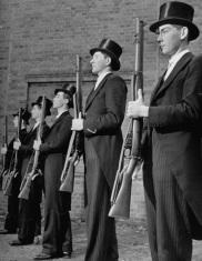 standing-in-arms-gentelmen-top-hats